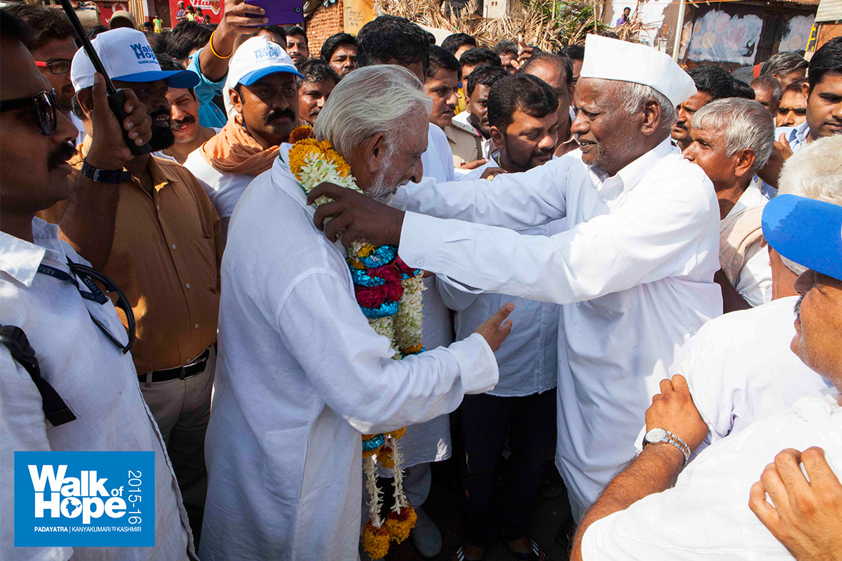 10.Sir-being-garlanded-at-Mummigatti,-Dharwad,-Karnataka
