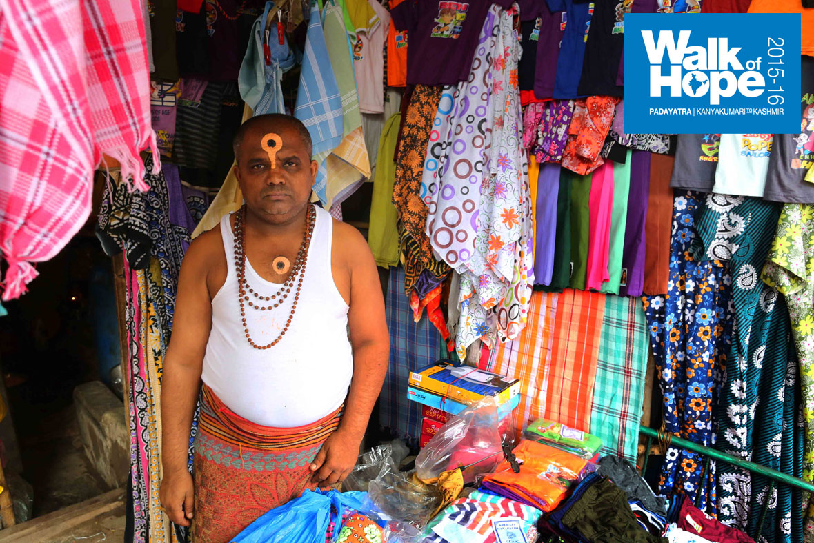 19.Sporting-a-unique-design-on-the-forehead-and-chest-is-this-textile-shop-owner-in-Nipani,-Karnataka