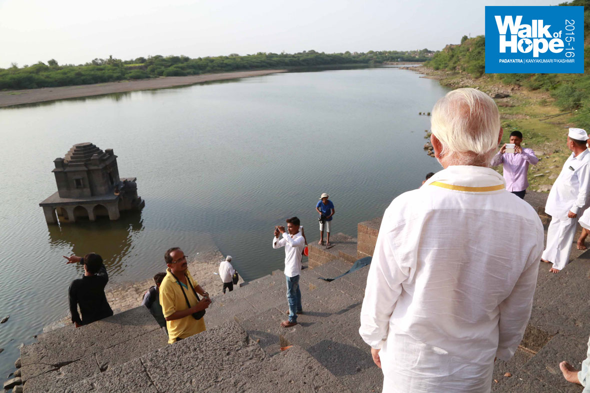 15.Sir-gazes-at-the-Bheema-river-and-the-temple-of-Lord-Siva-in-the-middle,-Machnoor,-Solapur,Maharashtra