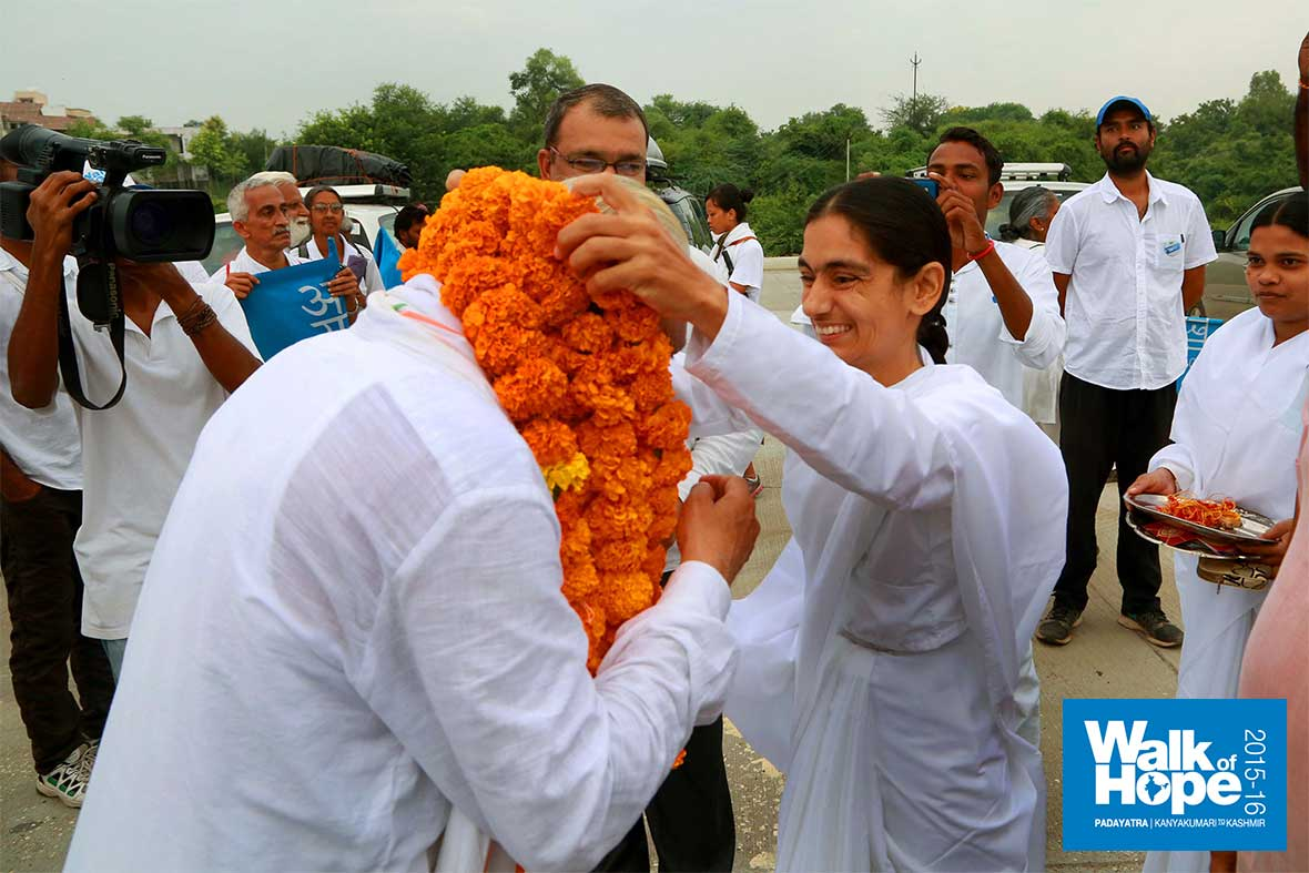 2.Sir-being-garlanded-by-Brahmakumaris,-Vasad,-Vadodara,-Gujarat