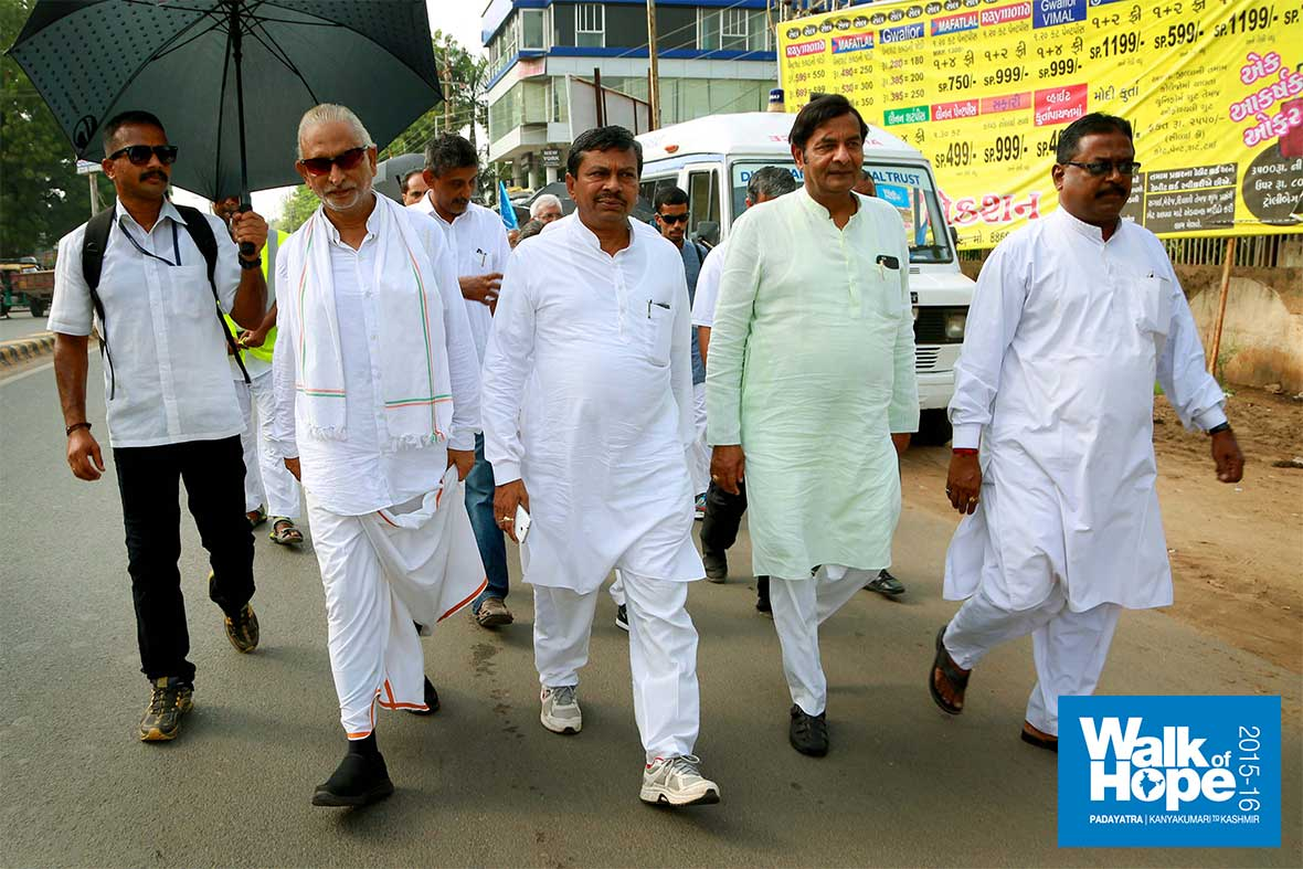 11.Sri-Dilip-Patel,-MP-of-Anand-&-Sri-Amit-Chawda,-MLA-of-Aklav-join-the-walk-at-Thakkarwadi,-Anand,-Gujarat