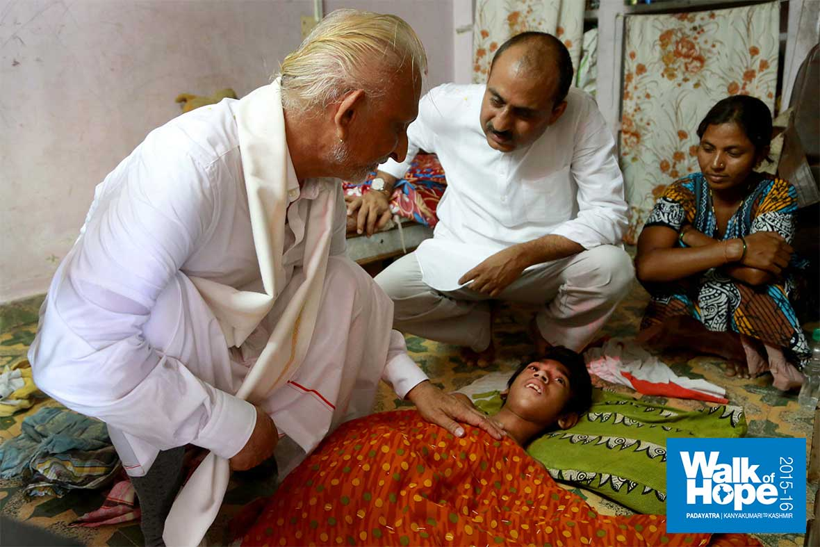 4.Sir-with-a-stricken-child-at-the-Gandhi-Leprosy-Centre,-Ahmedabad,-Gujarat