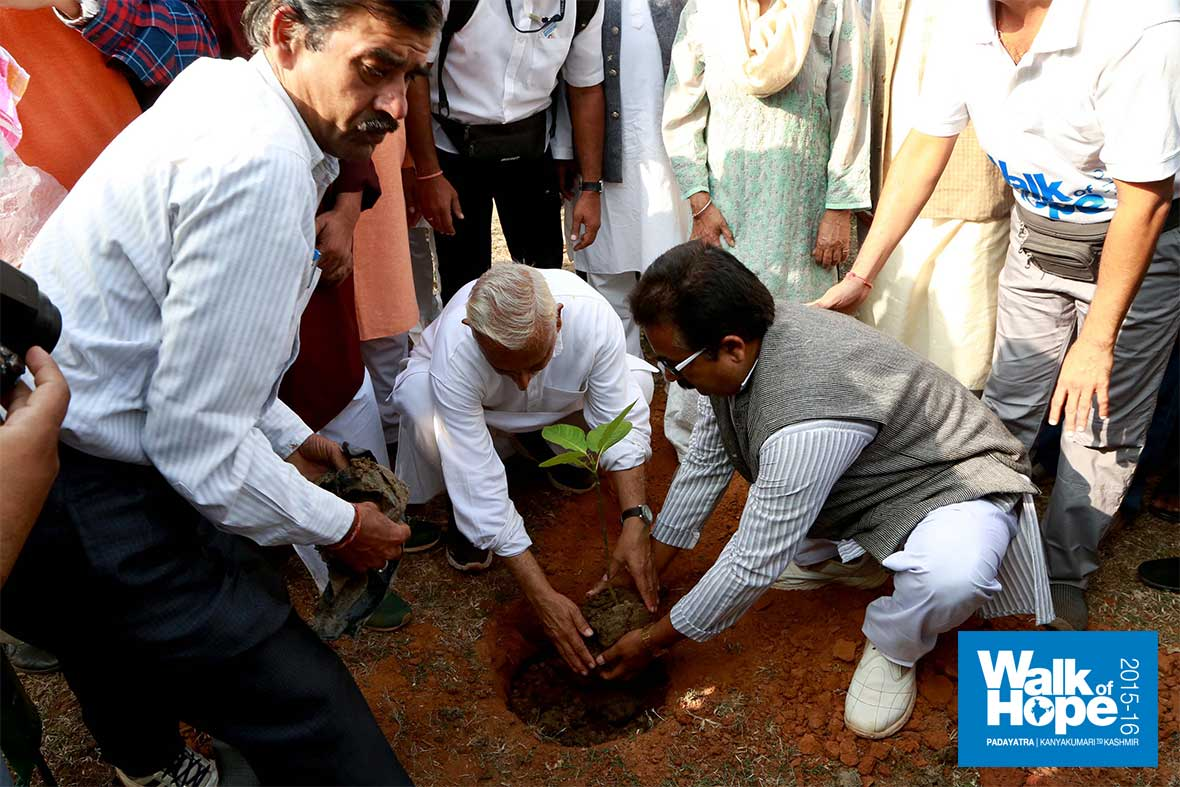 5.Sir-plants-a-sapling-in-the-compound-of-Sait-Raghunath-Prasad-University,-Hanumana,-Rewa,-MP