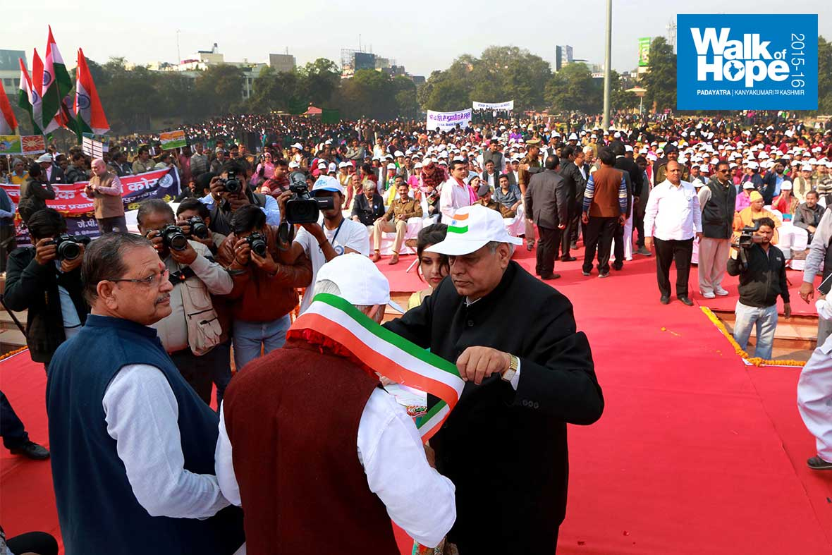 1.Sri-M-being-draped-with-a-tricolour-sash-at-Gandhi-Bhavan,-Kanpur,-UP