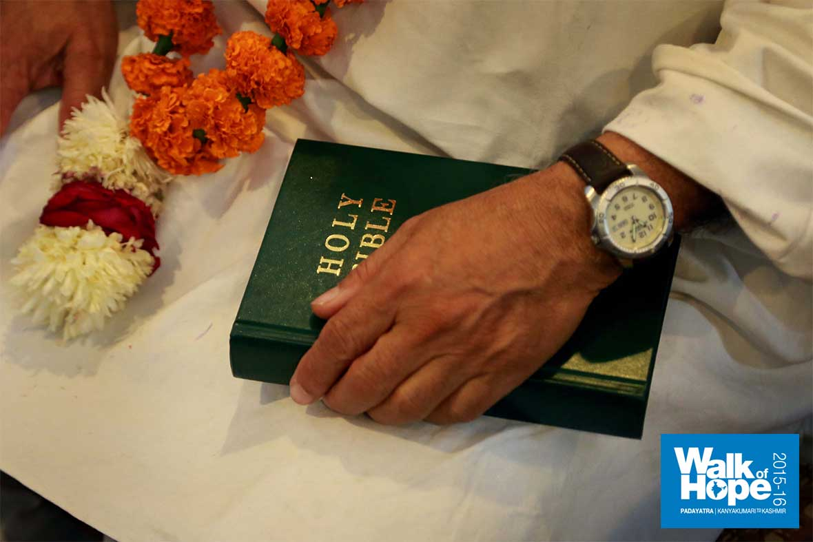 18.In-prayer-with-the-Holy-Bible-in-hand,-Sri-M-in-Christ-Church,-Kanpur,-UP