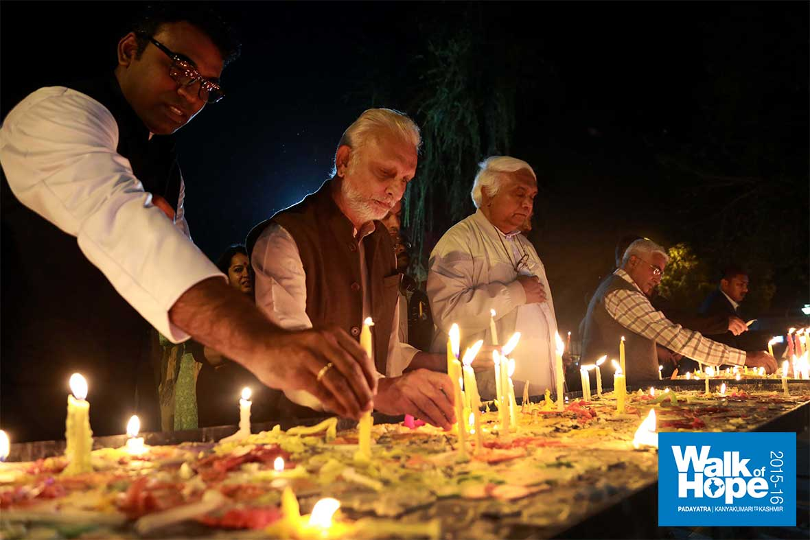 6.Lighting-candles-at-the-Grotto,-Sacred-Heart-Cathedral,-New-Delhi