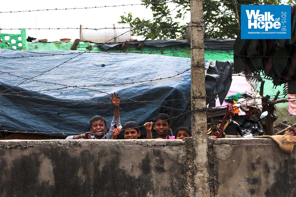 10.Winsome-smiles-across-a-barbed-wire-fence!,-Panchkula,-Haryana